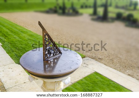 old sun clock dial in a garden Kingston, London, UK - stock photo