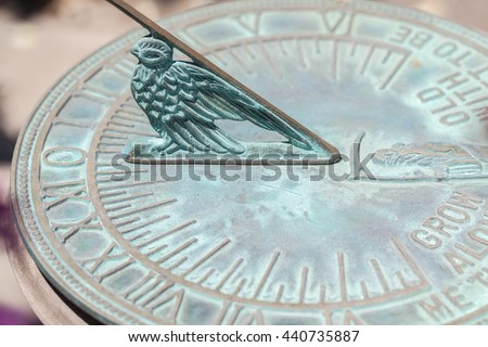 Old sun clock dial - Vintage sundial. Concept of time. Metal tool to measure time. - stock photo