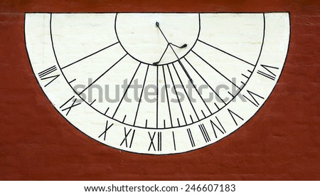 old sundial on the wall - stock photo