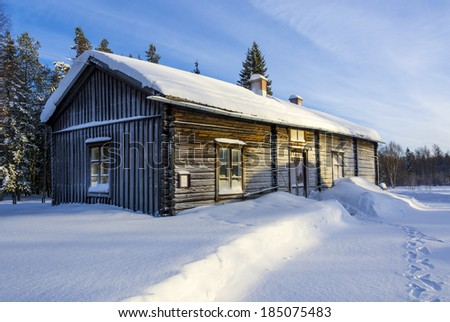 Old swedish farm house in snow Old wooden farm house in swedish countryside in winter and snow. - stock photo