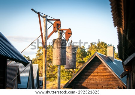 Old swedish fishing gears nest to fishing cabin - stock photo