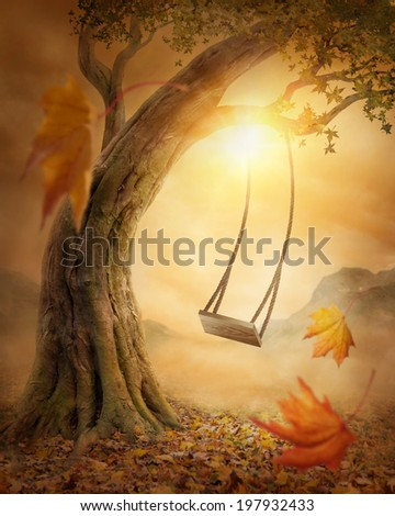 Old swing hanging from a large tree - stock photo