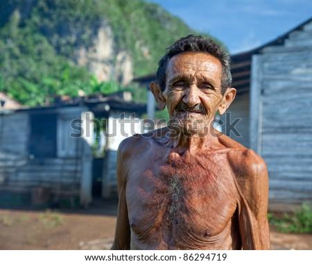 Old sympathetic cuban farmer , valley of Vinales, Cuba - stock photo