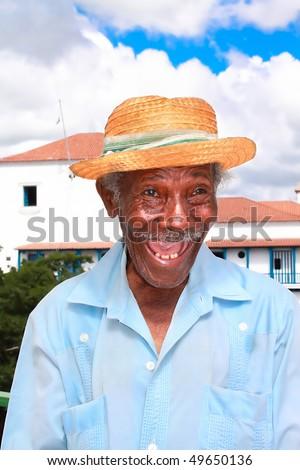 Old sympathetic cuban man with straw hat make a funny face, Santiago de Cuba, Cuba - stock photo