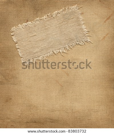 Old tag on the burlap background - stock photo