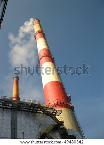 old tall chimney painted white with red - stock photo
