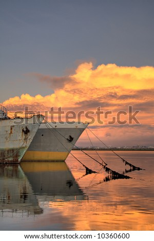 Old tankers in the sunset - stock photo