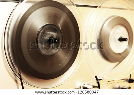 Old tape recorder playing - stock photo