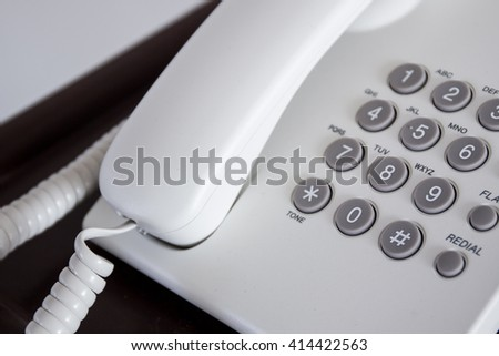 Old telephone on wooden tabel close up. - stock photo