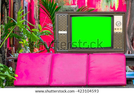Old television on vintage  background - stock photo
