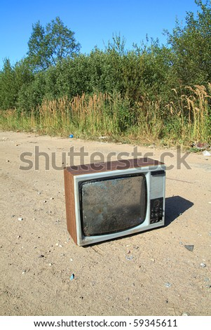 old television set on rural road - stock photo