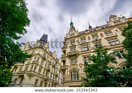 Old tenement house with dramatic sky in Prague, Czech Republic - stock photo