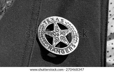 Old Texas ranger cowboy badge in black and white. - stock photo