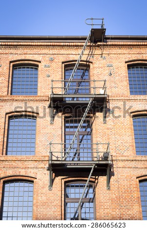 Old textile factory renewed as a museum - fire escapes - stock photo