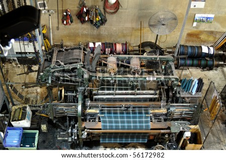 Old textile machine for manufacture flannelette - stock photo