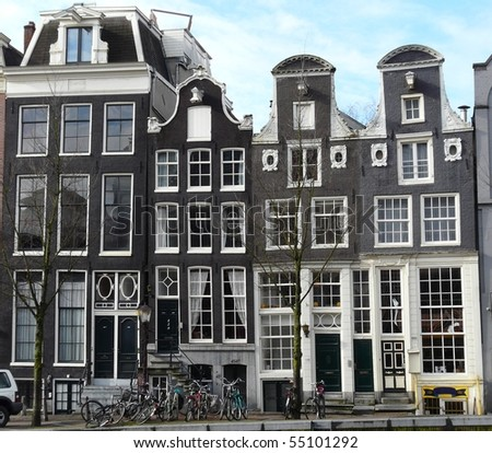 Old 17th and 18th century brick houses along the canals in Amsterdam in the Netherlands - stock photo