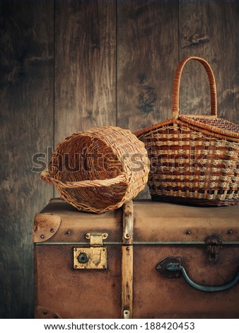 Old things. Baskets and Big Trunk - stock photo