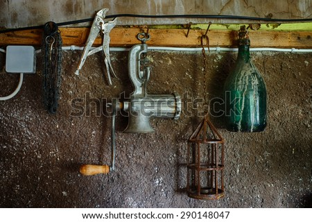 old things on the wall in the closet, grinder, bottle: HDR picture - stock photo