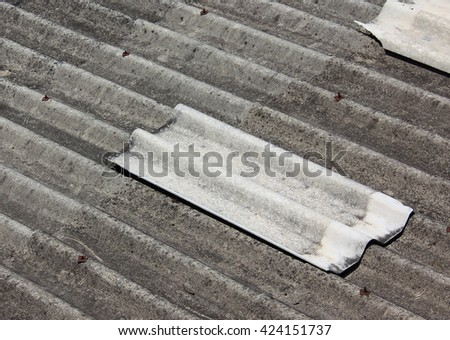 Old tile on the roof - stock photo
