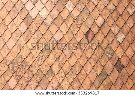 Old tile roof red brick background - stock photo