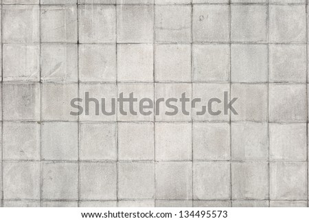 Old tiled white wall texture - stock photo