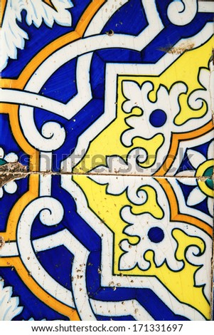 old tiles with ornament at a wall outsie - stock photo