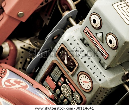 old tin toys in a box - stock photo
