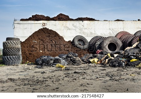 Old tires and waste of rubber ready for recycling - stock photo