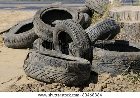 old tires on the roadside - stock photo