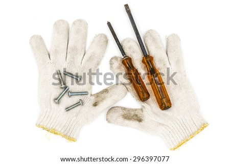 Old tools include Gloves, screwdrivers and nut - stock photo