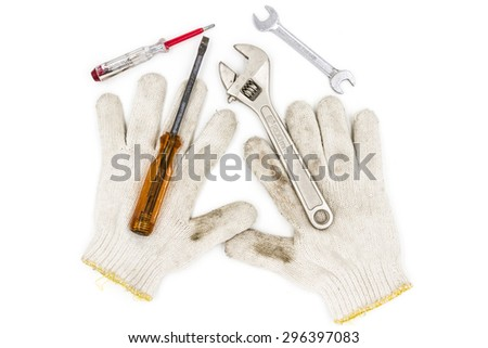 old tools include Gloves, wrench and screwdriver - stock photo