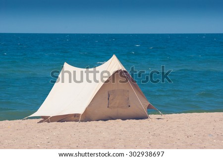 Old touristic tent on a beach of Black sea - stock photo