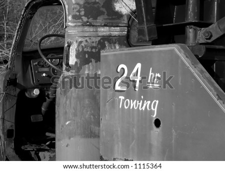 Old Tow Truck with 24 Hour Towing in Black and White - stock photo