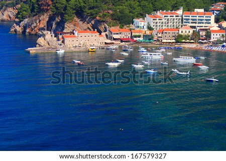 Old town and harbor on the shores of Adriatic sea - stock photo