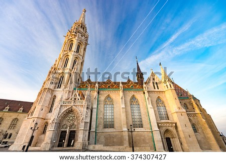 Old town architecture of Budapest. Buda temple church of Matthias. Buda's Castle District. Blue cloudy sky in background. Hungary, Europe. - stock photo