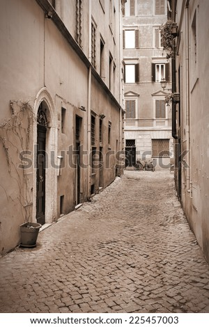 Old town cobbled street and Mediterranean architecture in Parione district of Rome, Italy. Sepia tone - retro monochrome color style. - stock photo