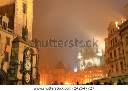 Old Town Hall and Astronomical Clock and the Church of Our Lady before Tyn in foggy autumn night, Prague, Czech Republic - stock photo