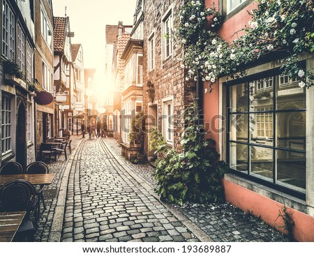 Old town in Europe at sunset with retro vintage Instagram style filter effect - stock photo