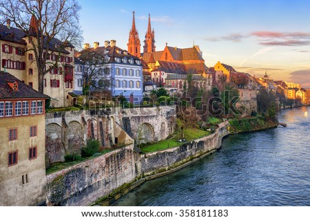 Old town of Basel with red stone Munster cathedral on the Rhine river, Switzerland - stock photo