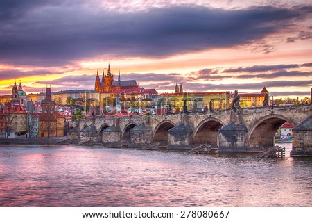 Old Town of Prague (Czech Republic) in the sunset. Skyline with Charles (Karluv) Bridge and Vltava River. Castle of Prague (Hrad) in the background. Picture fully represents main landmarks of the city - stock photo