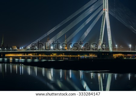 Old Town of Riga and River Daugava at night, Riga Cathedral, Saint Peter church and Riga castle in the background, Latvia - stock photo