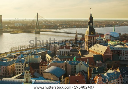 Old Town of Riga (Republic of Latvia) in the evening. Medieval streets of the biggest city in Baltic States. Daugava river with its beautiful bridges.  Aerial amazing representative picture of town. - stock photo