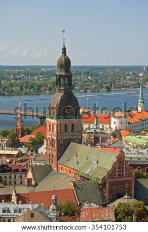 Old Town of Riga (Republic of Latvia) in the summer. Medieval streets of the biggest city in Baltic States. Daugava river. Aerial view from the tower St. Peter's Church. - stock photo