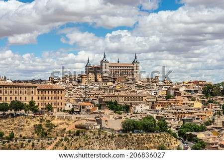 Old town of Toledo, with alcasar on a hilltop, former capital of Spain. - stock photo