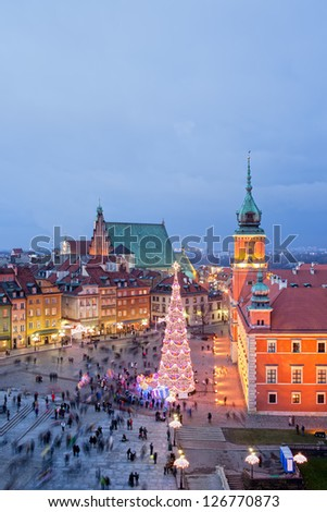 Old Town of Warsaw in Poland illuminated at evening, during Christmas time, composition with free space. - stock photo