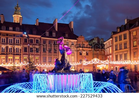 Old Town Square with Mermaid statue illuminated at night during Christmas Time in Warsaw, Poland. - stock photo