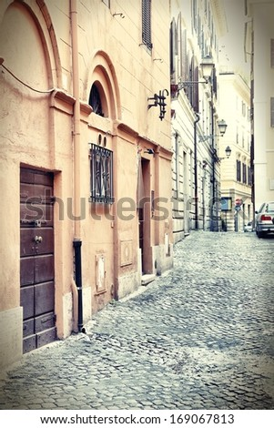 Old town view and Mediterranean architecture in Rome, Italy. Vintage retro photo colors - cross processing style. - stock photo