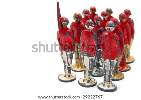 Old toy soldiers isolated on white background - stock photo