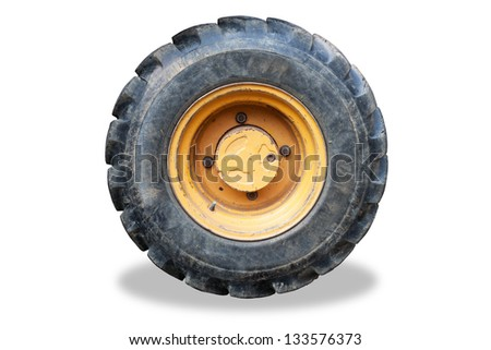Old Tractor wheel isolated on white background - stock photo