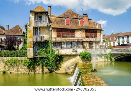 Old traditional building in Salies de Bearn, France. - stock photo